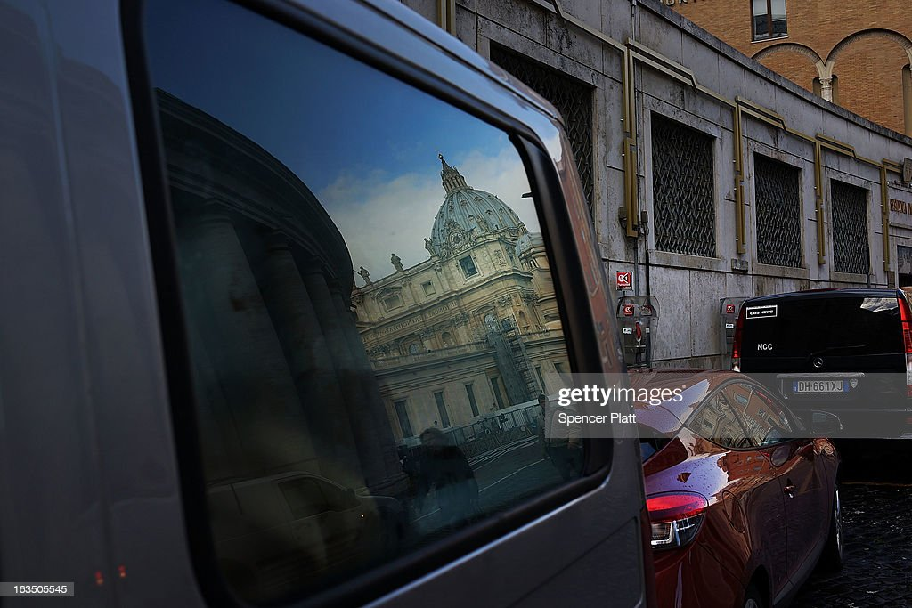 Saint Peter's Basilica is reflected in a car window on March 11, 2013 in Vatican City, Vatican. Cardinals are set to enter the conclave to elect a successor to Pope Benedict XVI after he became the first pope in 600 years to resign from the role. The conclave is scheduled to start on March 12 inside the Sistine Chapel and will be attended by 115 cardinals as they vote to select the 266th Pope of the Catholic Church.