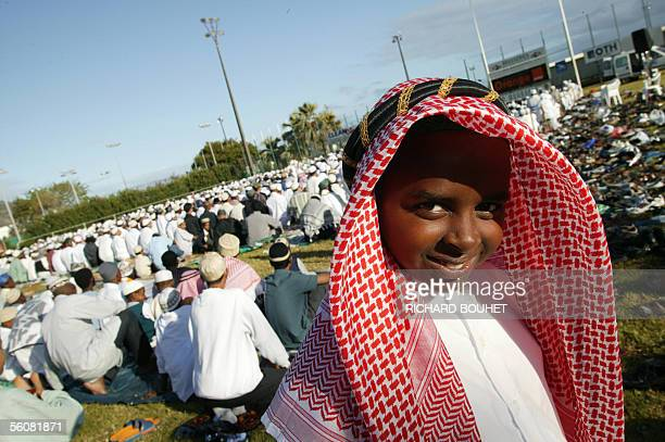 Some 200 Muslims pray in the Champ Fleuri stadium on the French Indian Ocean island of Reunion 04 November 2005 celebrating the end of the Muslim...