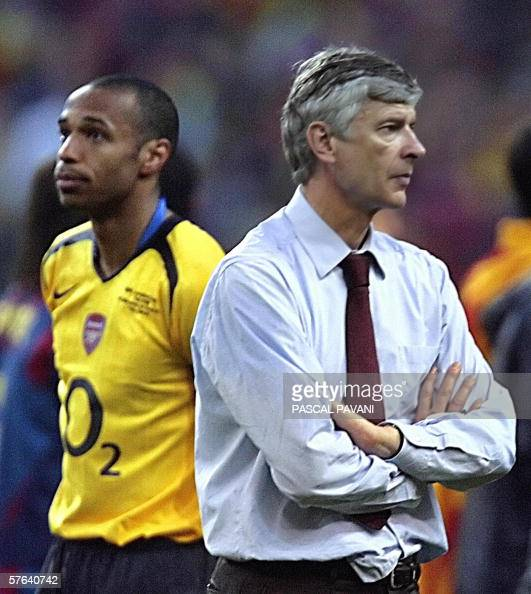 Arsenal's French forward and team captain Thierry Henry is seen next to Arsenal's French coach Arsene Wenger after the UEFA Champion's League final...