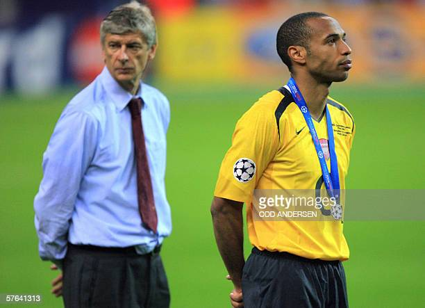 Arsenal's French forward and team captain Thierry Henry and Arsenal's French coach Arsene Wenger attend the trophy ceremony after the UEFA Champion's...
