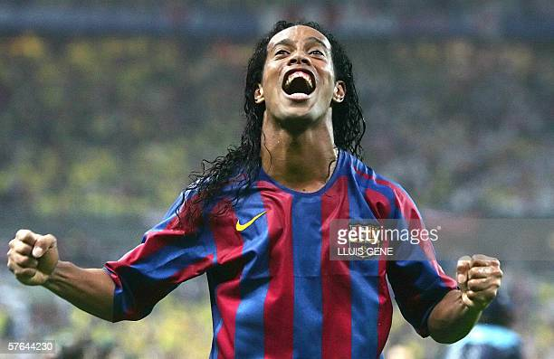 Barcelona's Brazilian forward Ronaldinho celebrates after winning the UEFA Champion's League final football match against Arsenal 17 May 2006 at the...