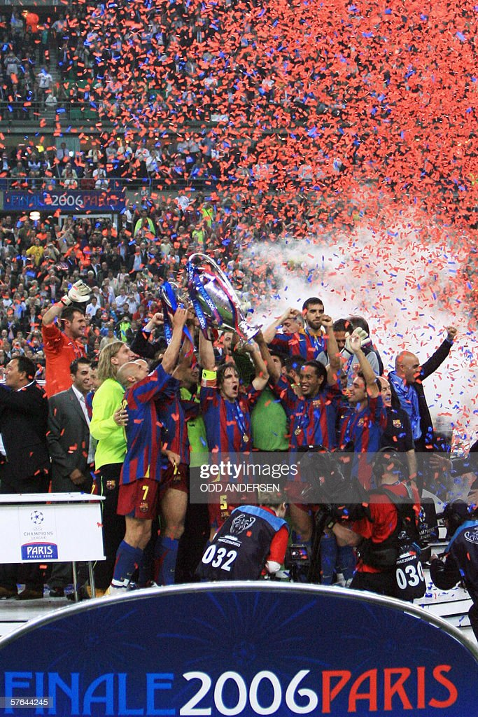 Barcelona's players celebrate after winning the UEFA Champion's League final football match against Arsenal 17 May 2006 at the Stade de France in...