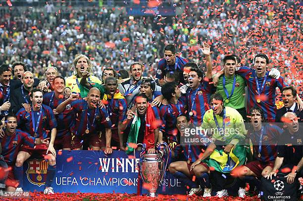 Barcelona's players celebrate with the trophy after winning the UEFA Champion's League final football match against Arsenal 17 May 2006 at the Stade...