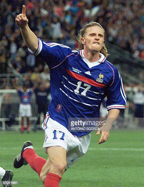 French Emmanuel Petit jubilates after scoring the 3rd goal for his team 12 July at the Stade de France in SaintDenis near Paris during the 1998...