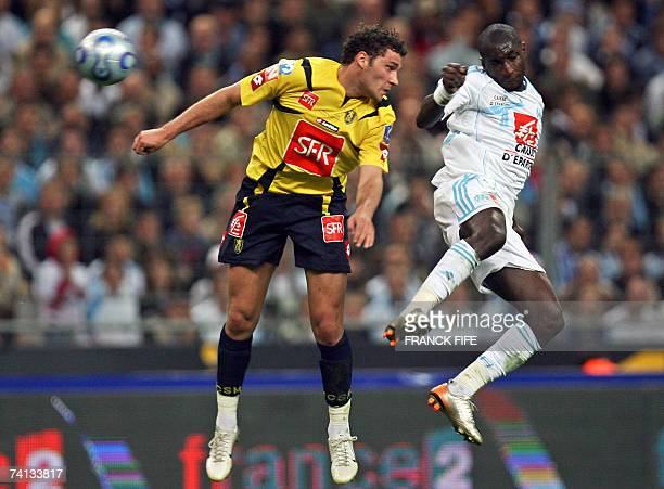 Marseille's Senegalese forward Mamadou Niang vies with Sochaux's midfielder Karim Ziani during the French cup final football match Marseille vs...