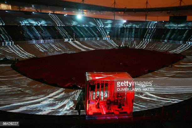 Musicians standing in a cabin perform on the pitch of the Stade de France stadium in SaintDenis outside of Paris 13 December 2005 during a rehearsal...