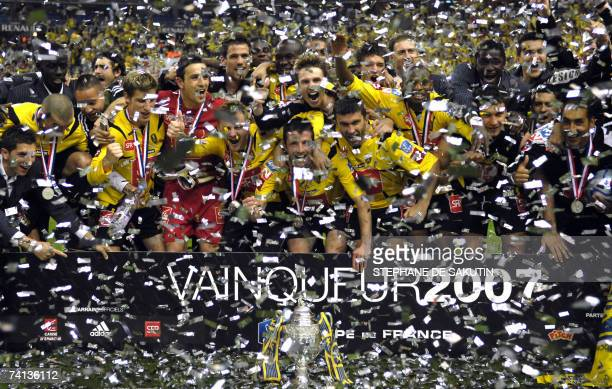 Sochaux's players celebrate with their trophy at the end of the French cup final football match Marseille vs Sochaux 12 May 2007 at the Stade de...