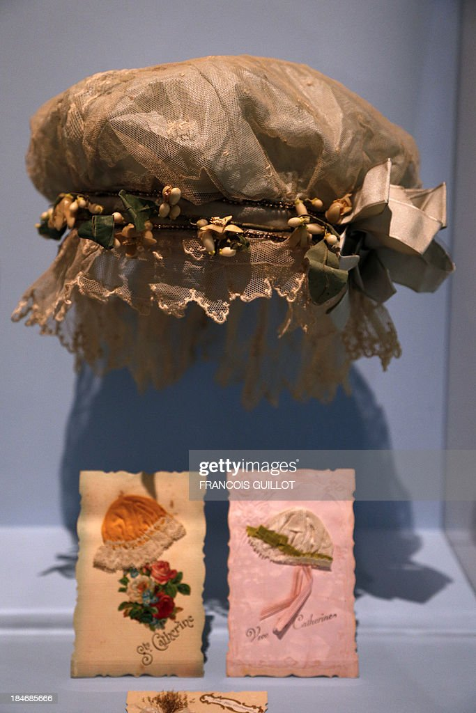 Sainte-Catherine headdress (for unmarried 25 year-old women -- also called Catherinette) is displayed during the 'Roman dune garde-robe, le chic dune Parisienne de la Belle Epoque aux années 30' (The novel of a wardrobe - The Parisian chic from the Belle Epoque to the 1930S) exhibition on October 15, 2013 at the Carnavalet Museum in Paris. The exhibition will run from October 17, 2013 until March 16, 2014.