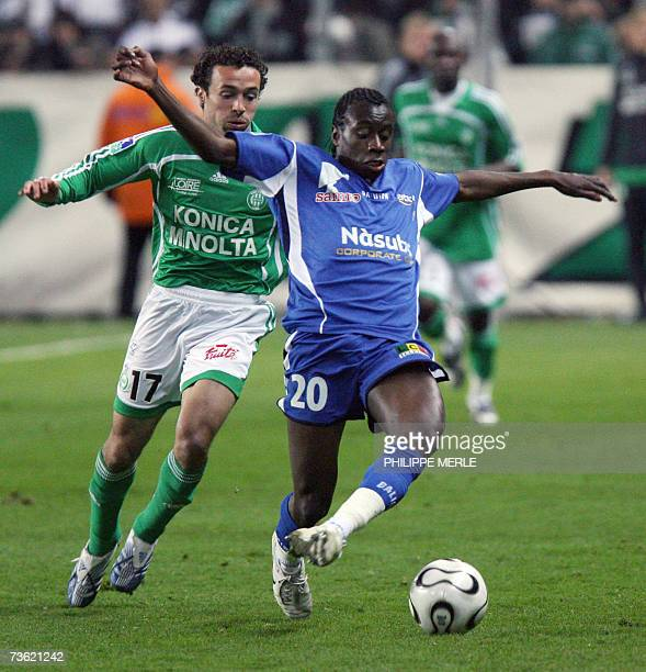 SaintEtienne's French midfielder Yohan Hautcoeur vies with Troyes' French midfielder Blaise Matuidi during their French L1 football match Saint...