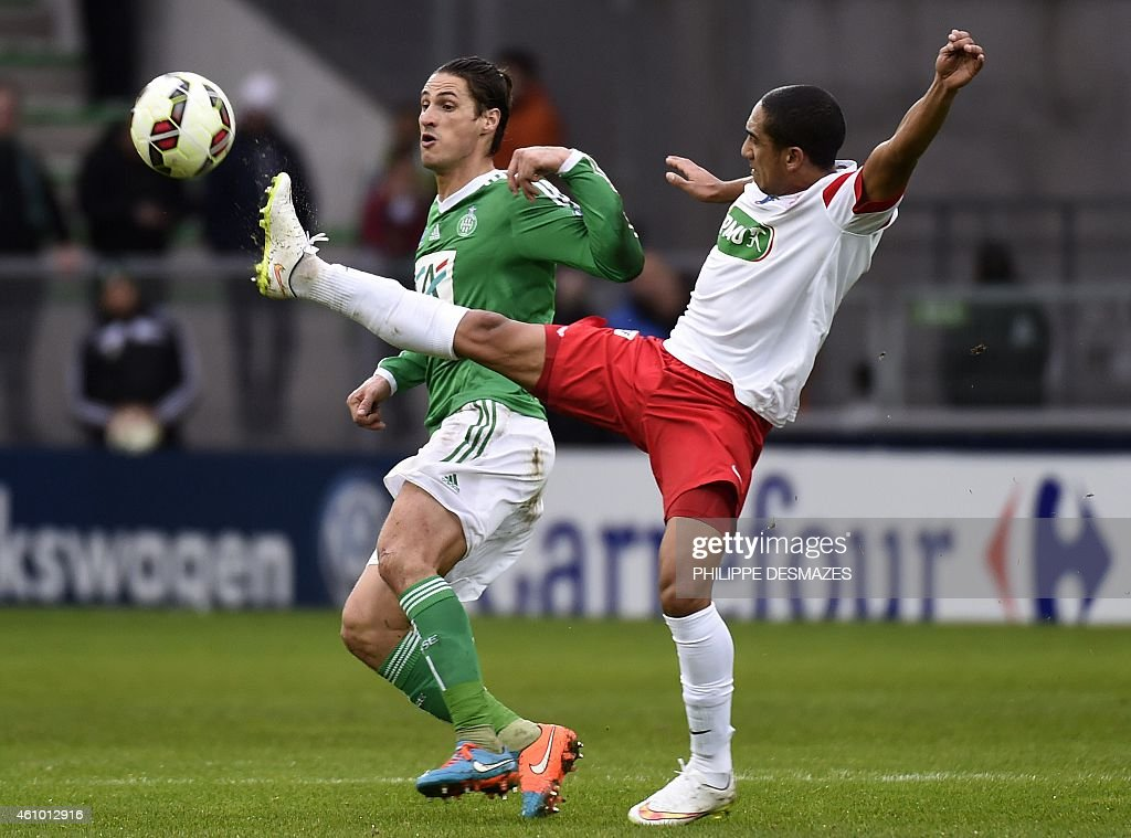 SaintEtienne midfielder Jeremy Clement fights for the ball with Nancy's Urugayan midfielder Jonathan Iglesias on January 4 2015 during a French Cup...
