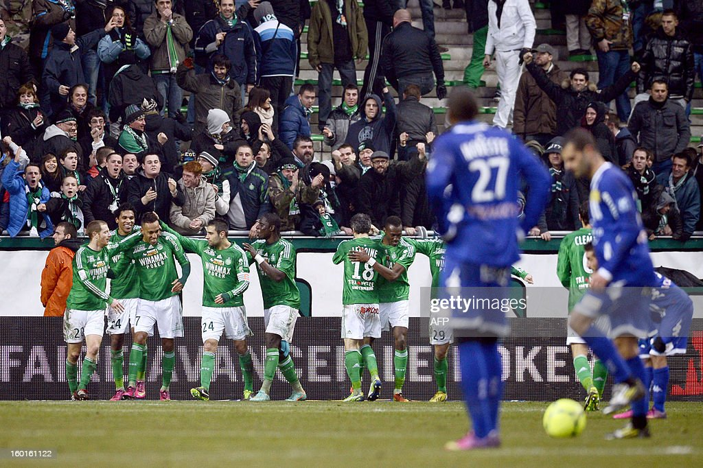 Saint-Etienne players celebrate after Saint-Etienne's Gabonese forward Pierre-Emerick Aubameyang (3rd L) scored a goal during the French L1 football match AS Saint-Etienne (ASSE) vs Bastia (SCB) on January 27, 2013, at the Geoffroy Guichard Stadium in Saint-Etienne, central France.