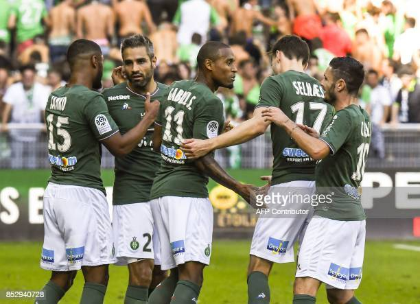 SaintEtienne's Brazilian defender Gabriel Silva is congratuled by teammates after scoring during the French L1 football match AS SaintEtienne vs...