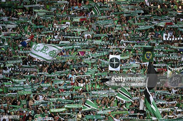 SaintEtienne's fans hold up scarves during the UEFA Europa League third qualifying round second leg football match between Romania's ASA 2013 Targu...