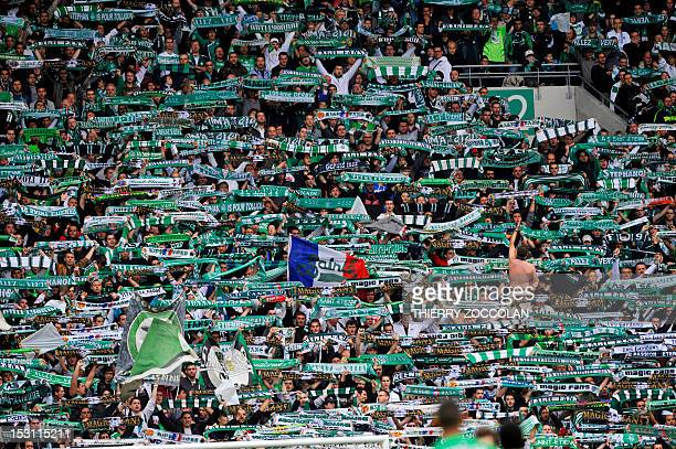 SaintEtienne's fans wave their team's flags and scarves during the French L1 football match SaintEtienne vs Reims which ended in a draw 00 on...