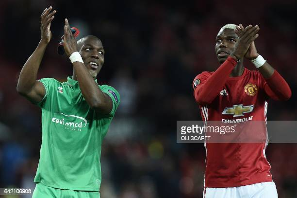 TOPSHOT SaintEtienne's French defender Florentin Pogba and his bother Manchester United's French midfielder Paul Pogba applaud the fans following the...