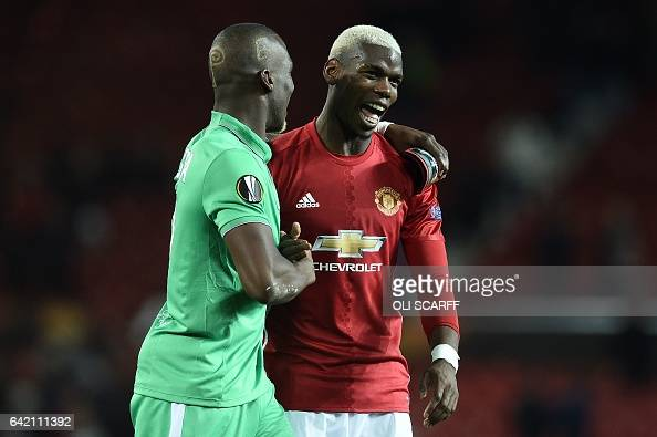 TOPSHOT SaintEtienne's French defender Florentin Pogba and his bother Manchester United's French midfielder Paul Pogba react following the UEFA...
