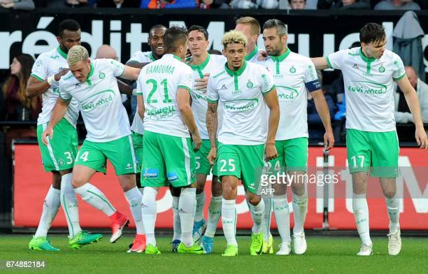 SaintEtienne's French defender Kevin Malcuit and teammates celebrate after scoring during the French Ligue 1 football match Guingamp vs SaintEtienne...