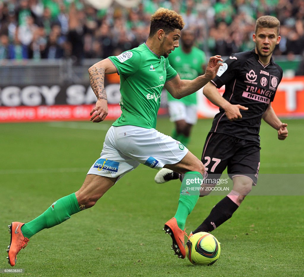 Saint-Etienne's French defender Kevin Malcuit (L) controls the ball during the French L1 football match between Saint Etienne and Toulouse at the Geoffroy Guichard stadium in Saint Etienne, central France, on April 30, 2016.