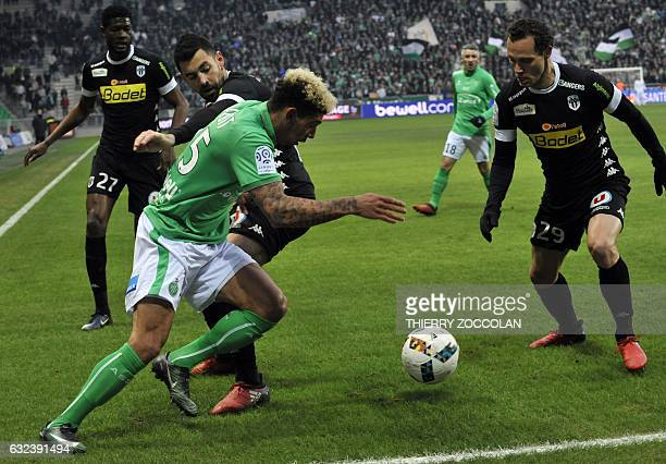 SaintEtienne's French defender Kevin Malcuit fights for the ball with Angers' French midfielder Vincent Manceau during the French L1 Football match...