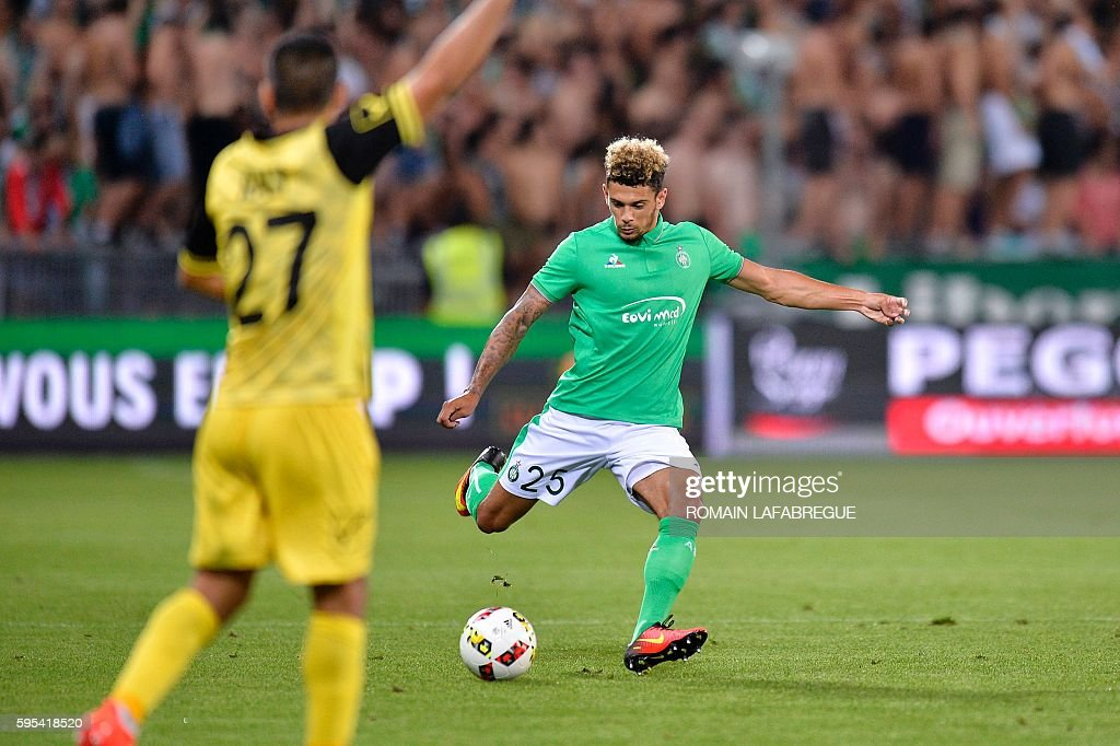SaintEtienne's French defender Kevin Malcuit kicks the ball during the UEFA Europa League playoff football match between AS SaintEtienne and Beitar...
