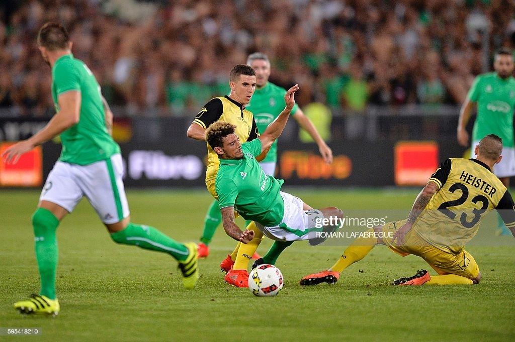 SaintEtienne's French defender Kevin Malcuit vies with Beitar Jerusalem's Marecel Heister during the UEFA Europa League playoff football match...