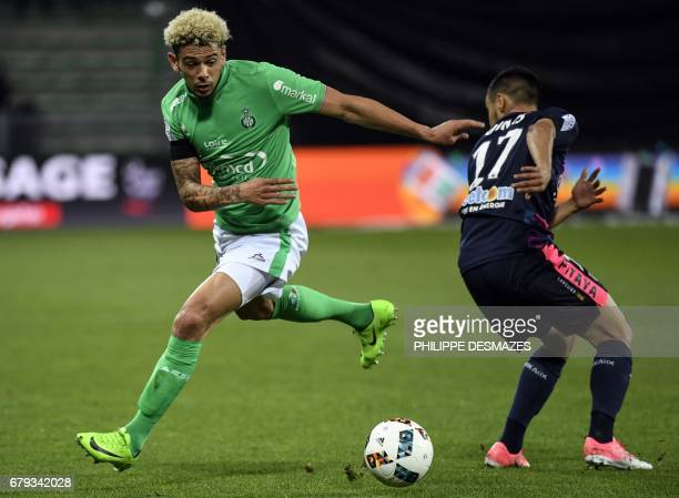 SaintEtienne's French defender Kevin Malcuit vies with Bordeaux's French midfielder Adam Ounas during the French L1 football match between AS...