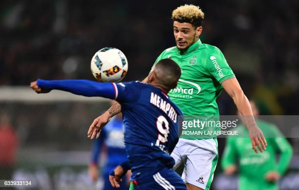 SaintEtienne's French defender Kevin Malcuit vies with Lyon's Dutch forward Memphis Depay during the French L1 football match between AS SaintEtienne...