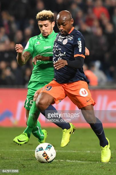 SaintEtienne's French defender Kevin Malcuit vies with Montpellier's Senegalese forward Souleymane Camara during the French L1 football match between...