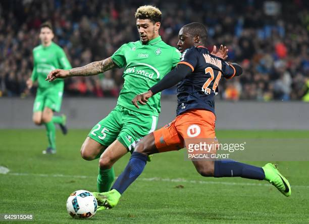 SaintEtienne's French defender Kevin Malcuit vies with Montpellier's French defender Jérôme Roussillon during the French L1 football match between...