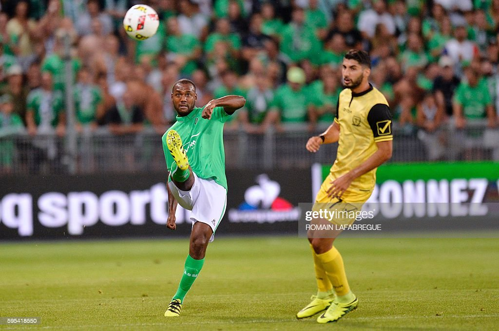 SaintEtienne's French defender Kevin TheophileCatherine shoots the ball during the UEFA Europa League playoff football match between AS SaintEtienne...
