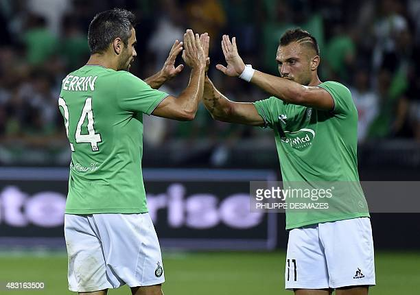 SaintEtienne's French defender Loic Perrin is congratuled SaintEtienne's French forward Yohan Mollo after Tirgu Mures scored an own goal during the...