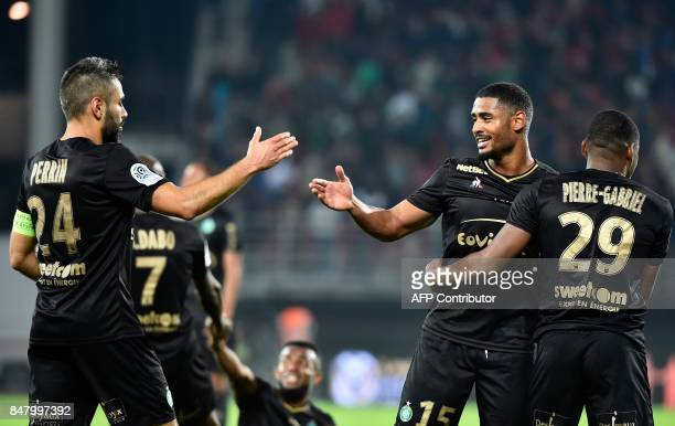 SaintEtienne's French defender Loic Perrin SaintEtienne's Swiss defender Said Janko and SaintEtienne's French forward Jonathan Bamba celebrate after...