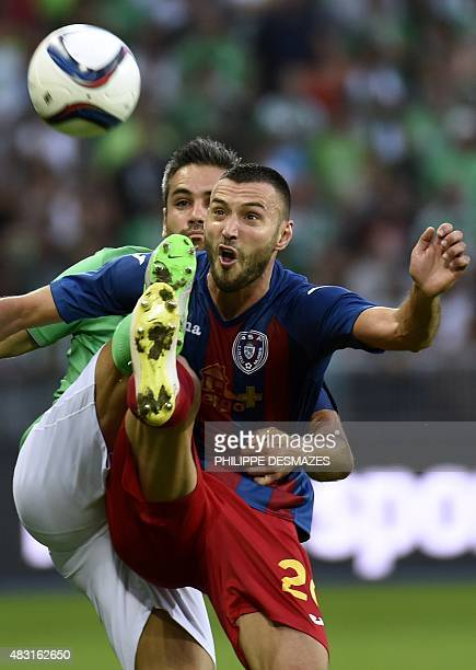 SaintEtienne's French defender Loic Perrin vies with Targu Mures' Romanian forward Mircea Axente during the UEFA Europa League third qualifying round...