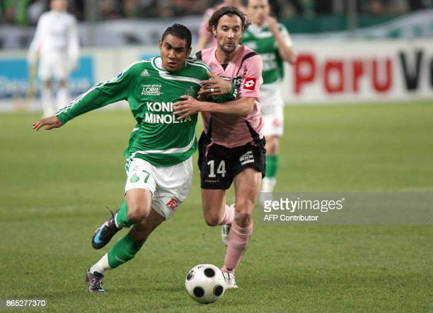 SaintEtienne's French forward Dimitri Payet vies with Toulouse's French midfielder Pantxi Sireix during their French L1 football match SaintEtienne...