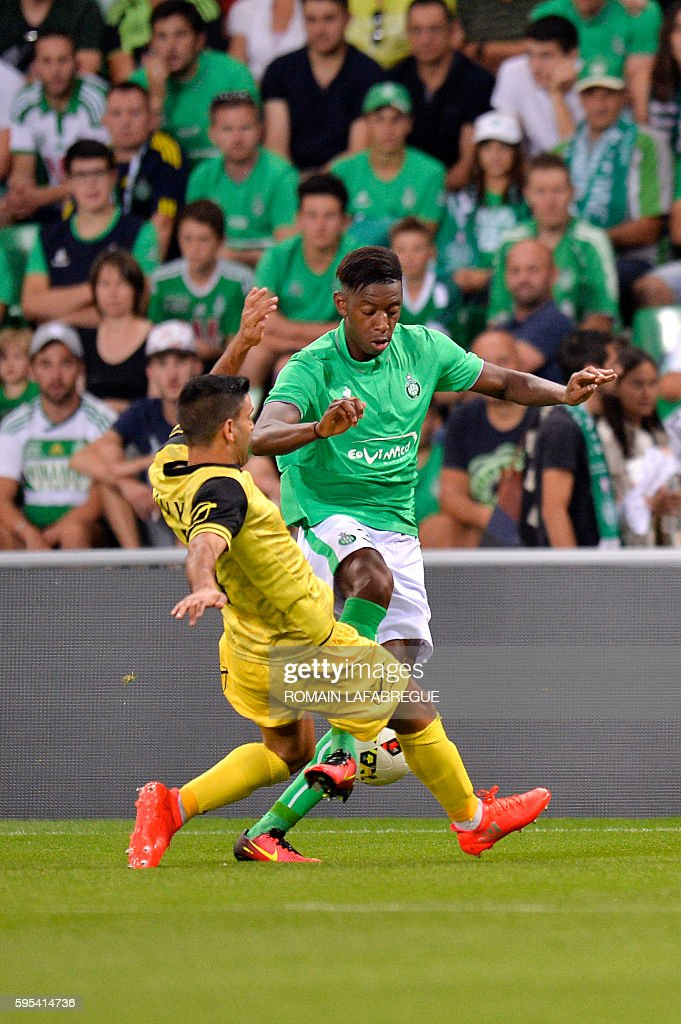 SaintEtienne's French forward Dylan SaintLouis vies for the ball with Beitar Jerusalem's Israeli midfielder Oz Rali during the UEFA Europa League...