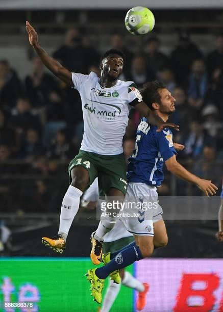 SaintEtienne's French forward Jonathan Bamba and Strasbourg's French midfielder Vincent Nogueira go for a header during the French League Cup round...