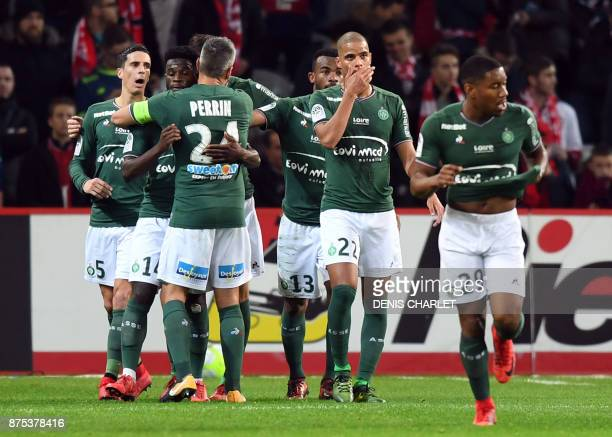 SaintEtienne's French forward Jonathan Bamba celebrates with teammates after scoring a goal during the French L1 football match between Lille and...
