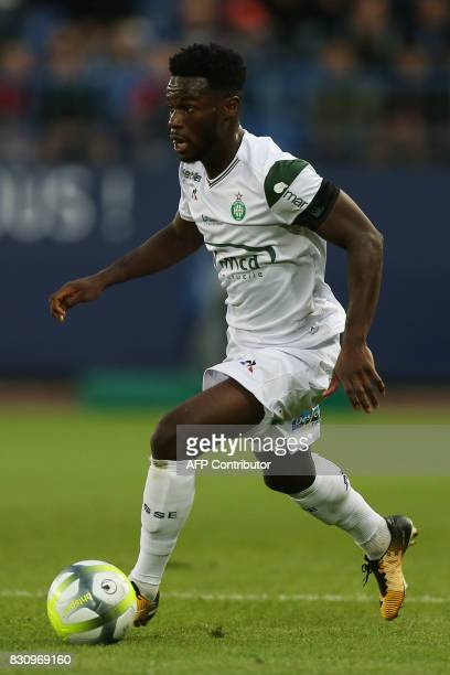 SaintEtienne's French forward Jonathan Bamba runs with the ball during the French L1 football match between Caen and SaintEtienne on August 12 at the...