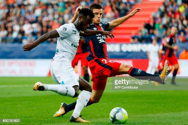 SaintEtienne's French forward Jonathan Bamba vies with Caen's French defender Frederic Guilbert during the French L1 football match between Caen and...