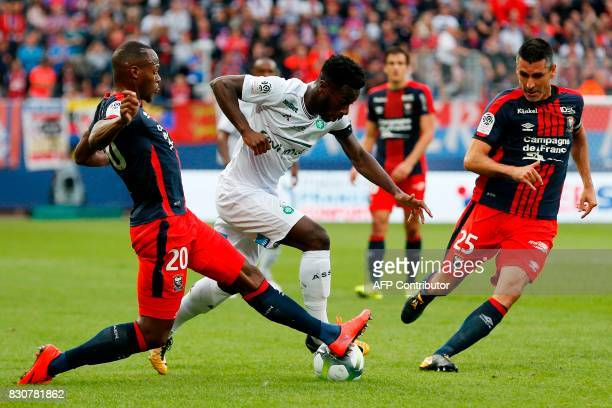 SaintEtienne's French forward Jonathan Bamba vies with Caen's French midfielder Julien Feret and French forward Herve Bazile during the French L1...