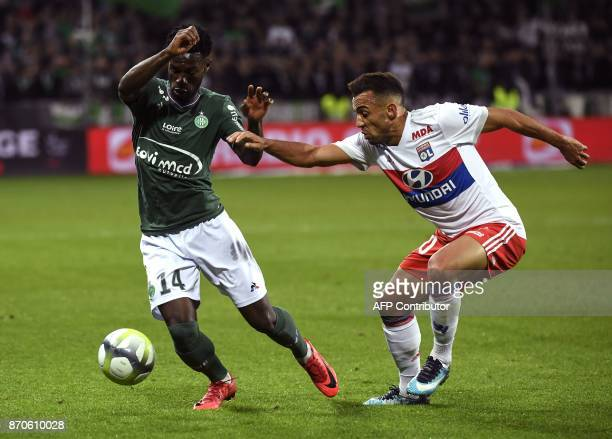 SaintEtienne's French forward Jonathan Bamba vies with Lyon's Brazilian defender Fernando Marcal during the French L1 football match between AS...