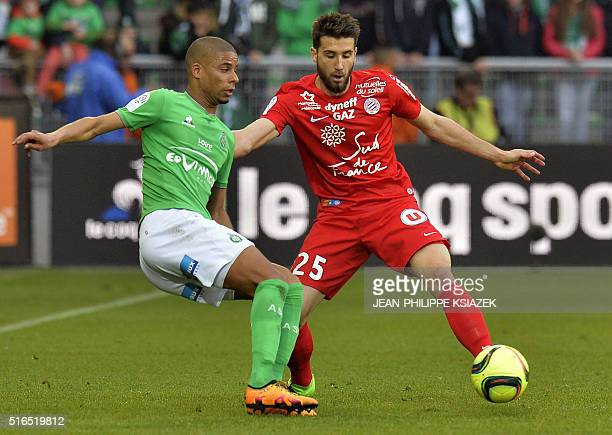 SaintEtienne's French forward Kevin MonnetPaquet vies with Montpellier's French defender Mathieu Deplagne during the French L1 football match between...