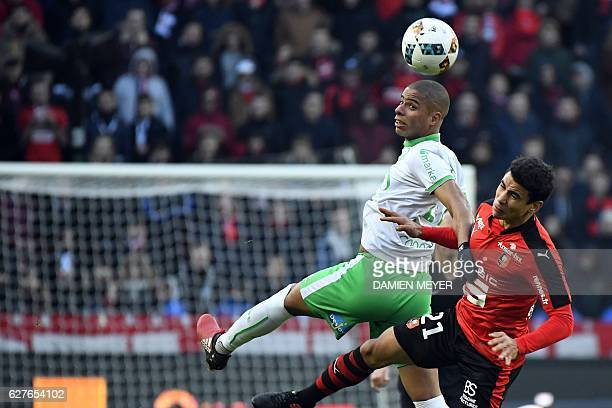 SaintEtienne's French forward Kevin MonnetPaquet vies with Rennes' French midfielder Benjamin Andre during the French L1 football match between...