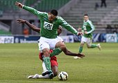 SaintEtienne's French forward Mevlut Erding is tackled by Nancy's French defender Joel Sami during the French Cup round of 64 football match between...
