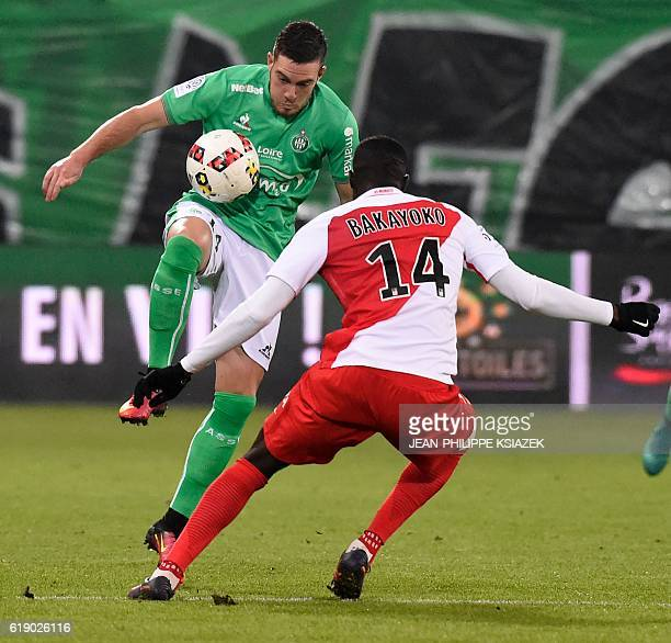 SaintEtienne's French forward Neal Maupay vies with Monaco's French midfielder Tiemoue Bakayoko during the French L1 football match SaintEtienne vs...
