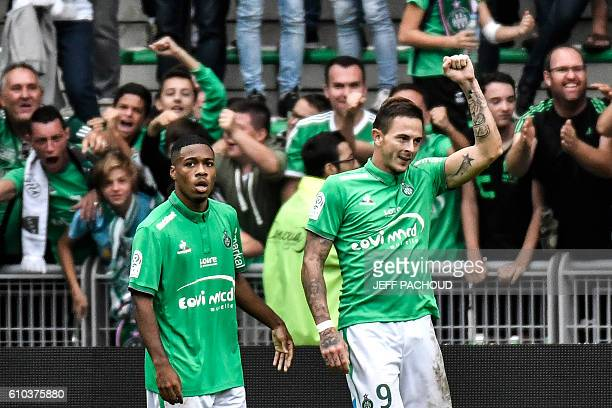 SaintEtienne's French forward Nolan Roux celebrates after scoring a goal during the French L1 football match AS SaintEtienne vs Lille on September 25...