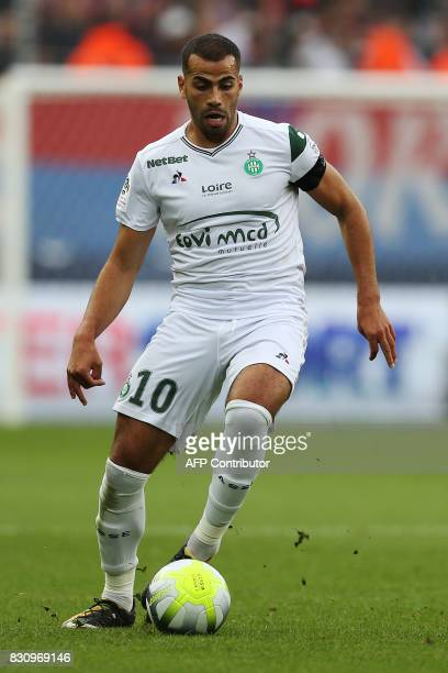 SaintEtienne's French forward Oussama Tannane runs with the ball during the French L1 football match between Caen and SaintEtienne on August 12 at...