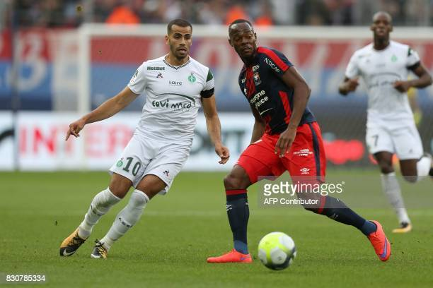 SaintEtienne's French forward Oussama Tannane vies with Caen's French forward Herve Bazile during the French L1 football match between Caen and...