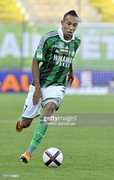 SaintEtienne's French forward PierreEmerick Aubameyang runs with the ball during the French L1 football match SaintEtienne versus Nancy on August 13...