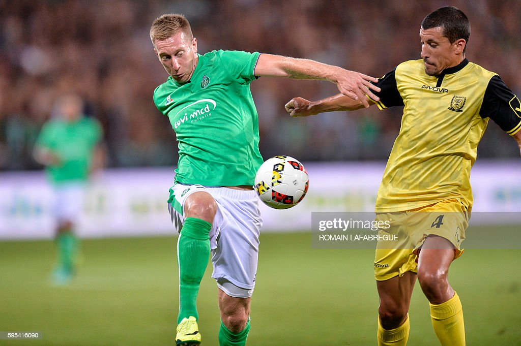 SaintEtienne's French forward Slovenian Robert Beric vies with Beitar Jerusalem's Spanish defender Jesus Rueda during the UEFA Europa League playoff...